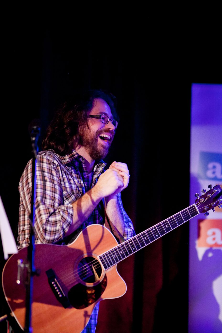 Musician Jonathan Coulton laughs while delivering the tunes on Ask Me Another. (Steve McFarland)