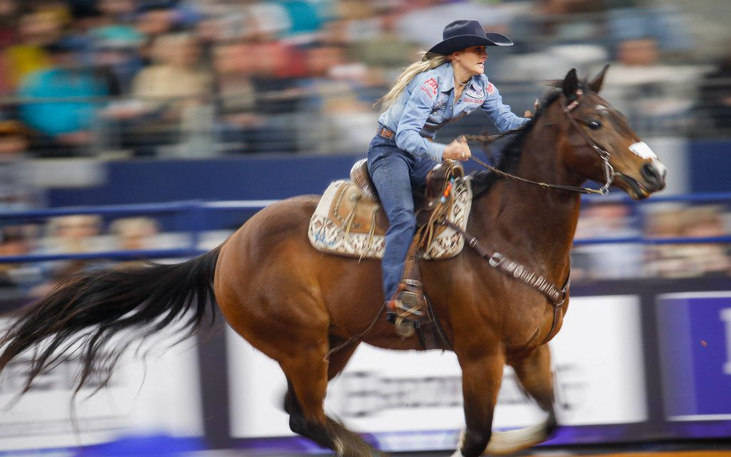 Stevi Hillman, of Weatherford, competes in the barrel racing competition of RFD-TV's The American rodeo at AT&T Stadium on March 8, 2020, in Arlington.