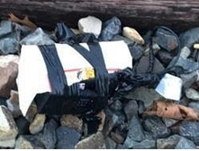 An image of what appeared to be a bomb, found on Dallas' Kansas City Rail Line in December 2018. Mark Ashley Robert pleaded guilty to placing it there, court documents say.