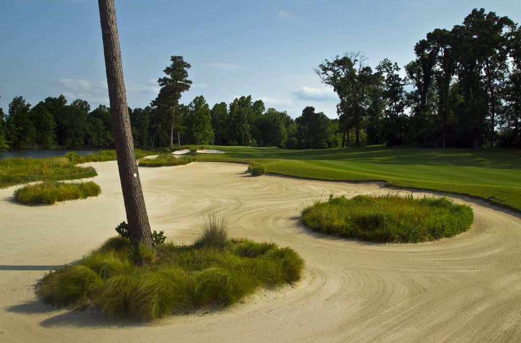 The vast array of sand on the No. 13, par 4 separates the fairway and water at Whispering Pines Golf Club in Trinity, TX, Wednesday, May 18, 2011.  (Tom Fox/The Dallas Morning News)