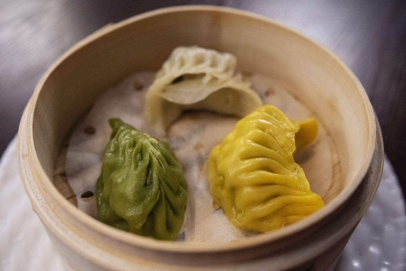 A comb dumpling of veggie, left, pork/shrimp and chicken, right, from Kitchen Master in Frisco, Sunday, May 31, 2020.