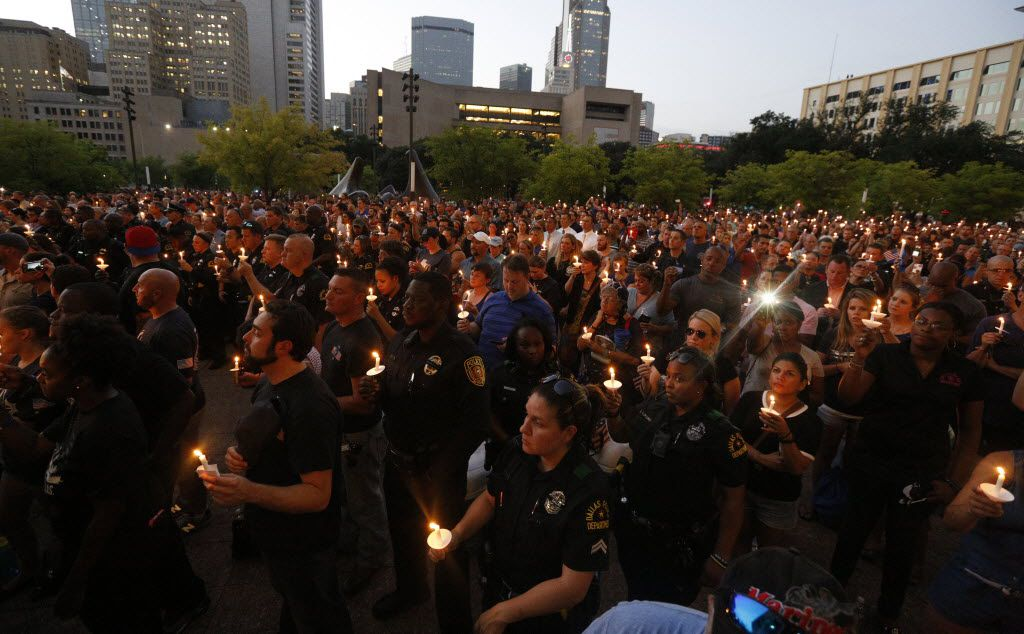 Hundres remember fallen officer during a candlelight vigil hosted by the Dallas Police Association at Dallas City hall in Dallas, TX July 11, 2016. (Nathan Hunsinger/The Dallas Morning News)
