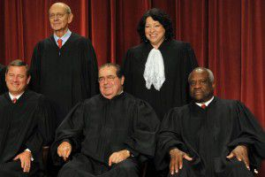 Justice Antonin Scalia (front center), above in a group picture of the Supreme Court in 2009, died Saturday at the age of 79. Also pictured John G. Roberts and Clarence Thomas (bottom row) and Stephen G. Breyer and Sonia Sotomayor (top row). (Bill O'Leary/The Washington Post)