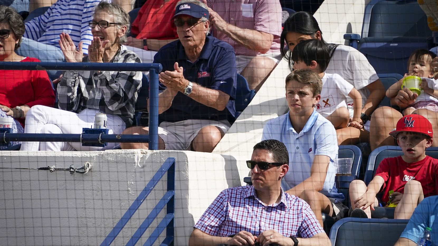 Texas Ranges president, baseball operations, Jon Daniels  watches an NCAA baseball game between Mississippi and Vanderbilt at Swayze Field on Saturday, May 15, 2021, in Oxford, Miss.