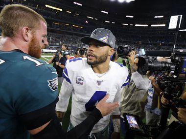 Philadelphia Eagles quarterback Carson Wentz (11) stops and congratulates Dallas Cowboys quarterback Dak Prescott (4) on their 37-10 win at AT&T Stadium in Arlington, Texas, Sunday, October 20, 2019. The Cowboys won, 37-10. (Tom Fox/The Dallas Morning News)