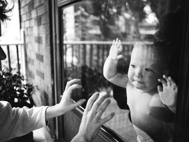 """Photographer Debora Hunter rediscovered her 1989 photo """"Baby Behind Glass"""" last year around the beginning of the pandemic. The past year has made her grateful, she says, """"for the things I have and the things that I don't have."""""""