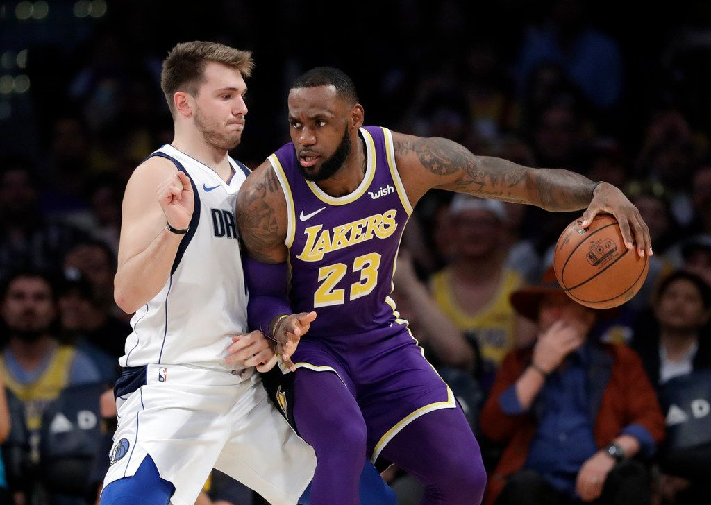 Los Angeles Lakers' LeBron James (23) is defended by Dallas Mavericks' Luka Doncic during the first half of an NBA basketball game Wednesday, Oct. 31, 2018, in Los Angeles