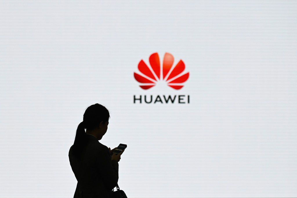 A staff member of Huawei uses her mobile phone at the Huawei Digital Transformation Showcase in Shenzhen, China's Guangdong province.