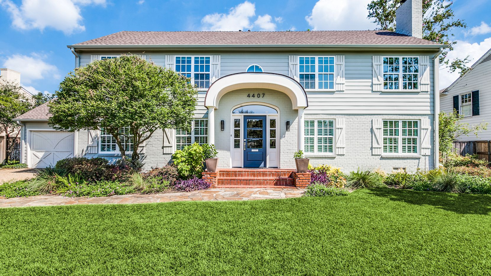 The remodeled four-bedroom home at 4407 Shirley Drive in Preston Hollow features a remodeled kitchen, pool and primary suite.