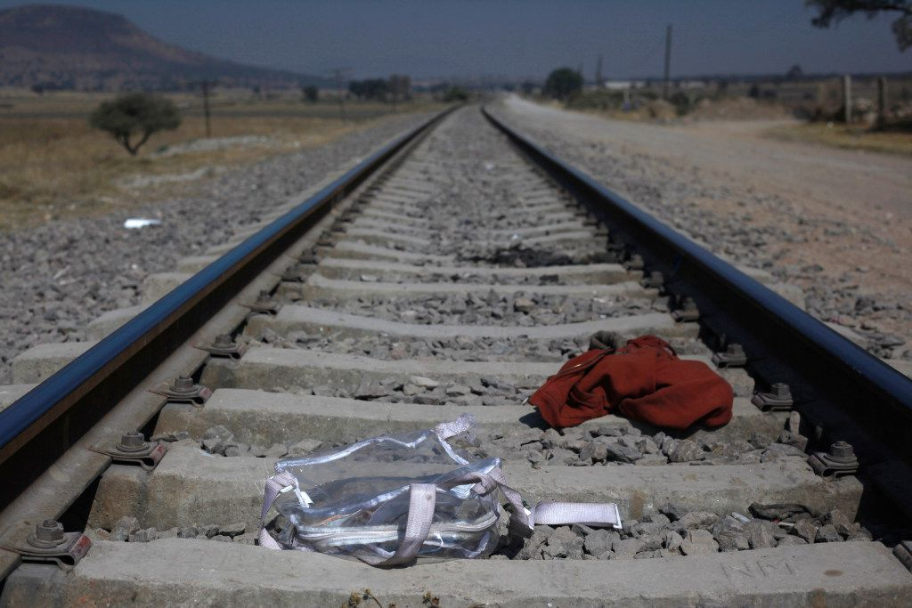Central American migrants wait near these tracks of a northbound train. (AP Photo/Marco Ugarte)