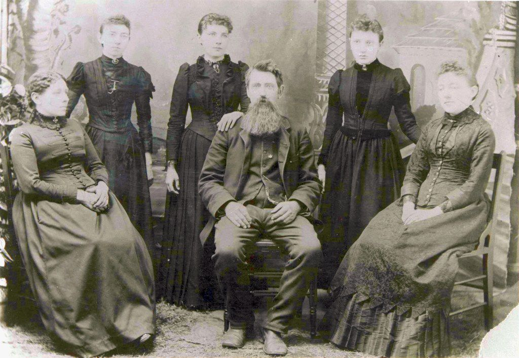 "The Ingalls Family in 1894: Seated, from left: Caroline, Charles and Mary Ingalls. Standing: Carrie Ingalls, Laura Ingalls Wilder and Grace Ingalls. From "" Prairie Fires: The American Dreams of Laura Ingalls Wilder."""