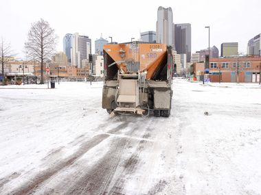 A City of Dallas Mobility and Street Services truck spreads de-icing materials downtown a winter storm brought snow and freezing temperatures to North Texas on Tuesday, Feb. 16, 2021, in Dallas. Another winter storm could dump 5 more inches of snow on Dallas-Fort Worth. (Smiley N. Pool / Staff Photographer)