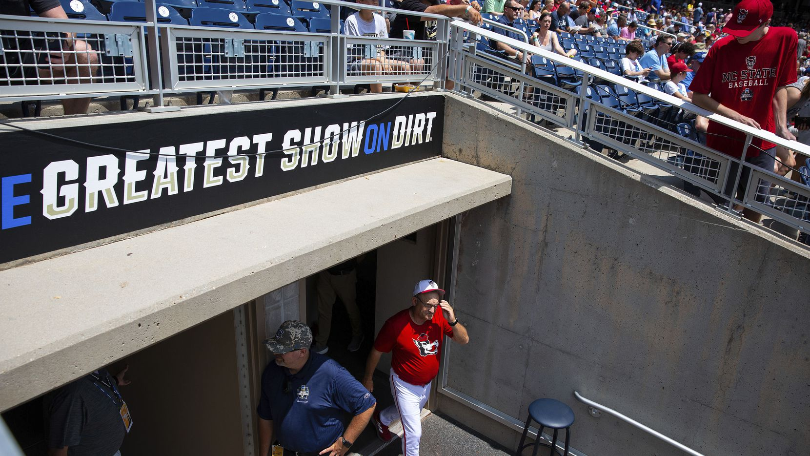 North Carolina State head Coach Elliott Avent exits the locker room during a delay due to COVID-19 safety protocols before their baseball game against Vanderbilt at the College World Series Friday, June 25, 2021, at TD Ameritrade Park in Omaha, Neb.