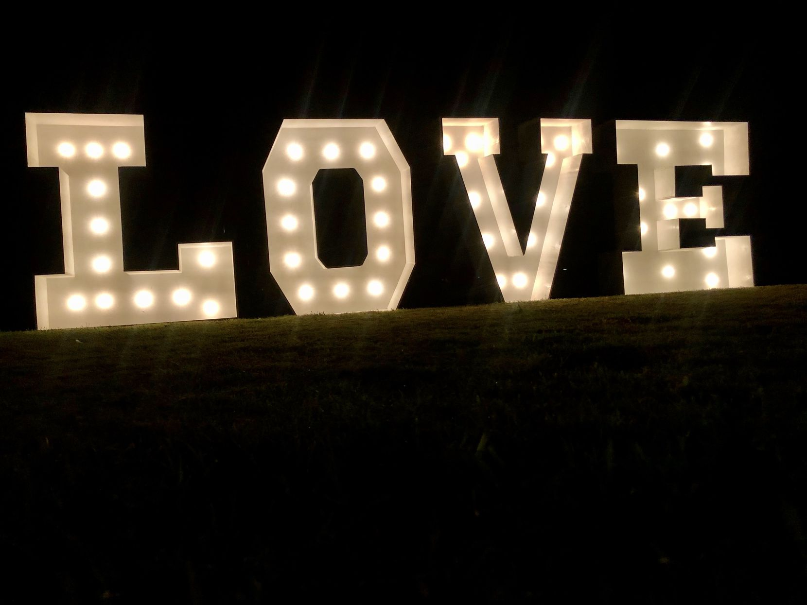 "Newly founded Lone Star Bubbles & Brews is an event prop rental business based in Colleyville, TX. Pictured here is the ""Love"" sign."