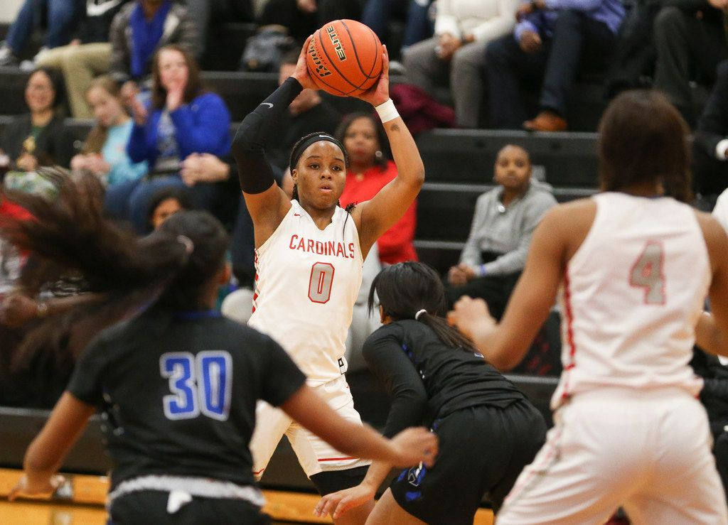 MacArthur junior guard Sarah Andrews (0) looks to make a pass to senior forward Tailor Broussard (4) during a matchup between the MacArthur Cardinals and the Hebron Hawks on Tuesday, Jan. 29, 2019 in Irving, Texas. (Ryan Michalesko/The Dallas Morning News)