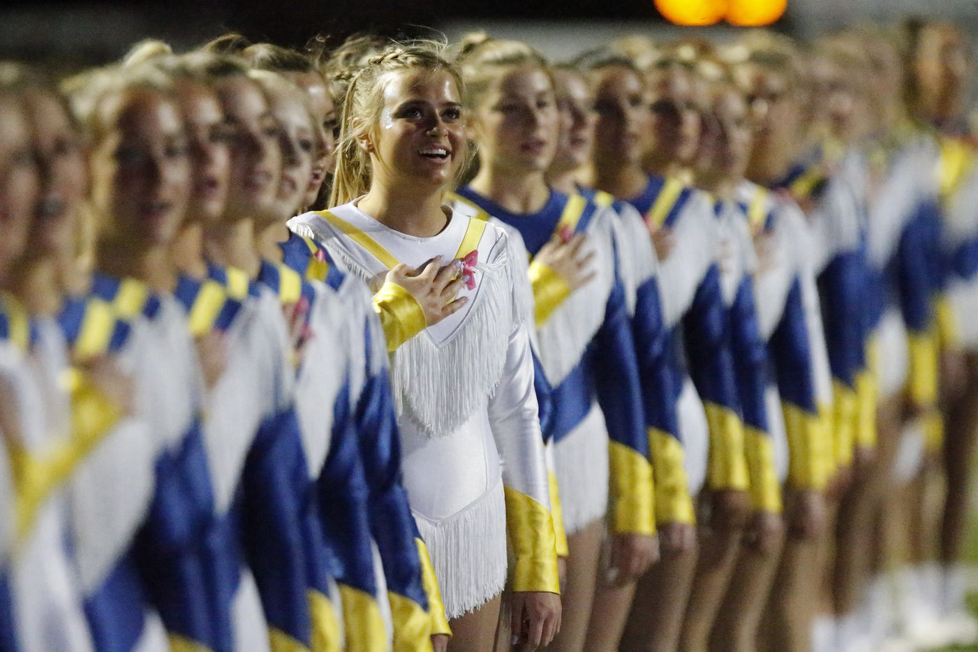 Chloe Walsh with the Highland Park High School Belles drill team stands at attention during the national anthem as Highland Park High School hosted Longview High School at Highlander Stadium in Dallas on Friday night, October 8, 2021. (Stewart F. House/Special Contributor)