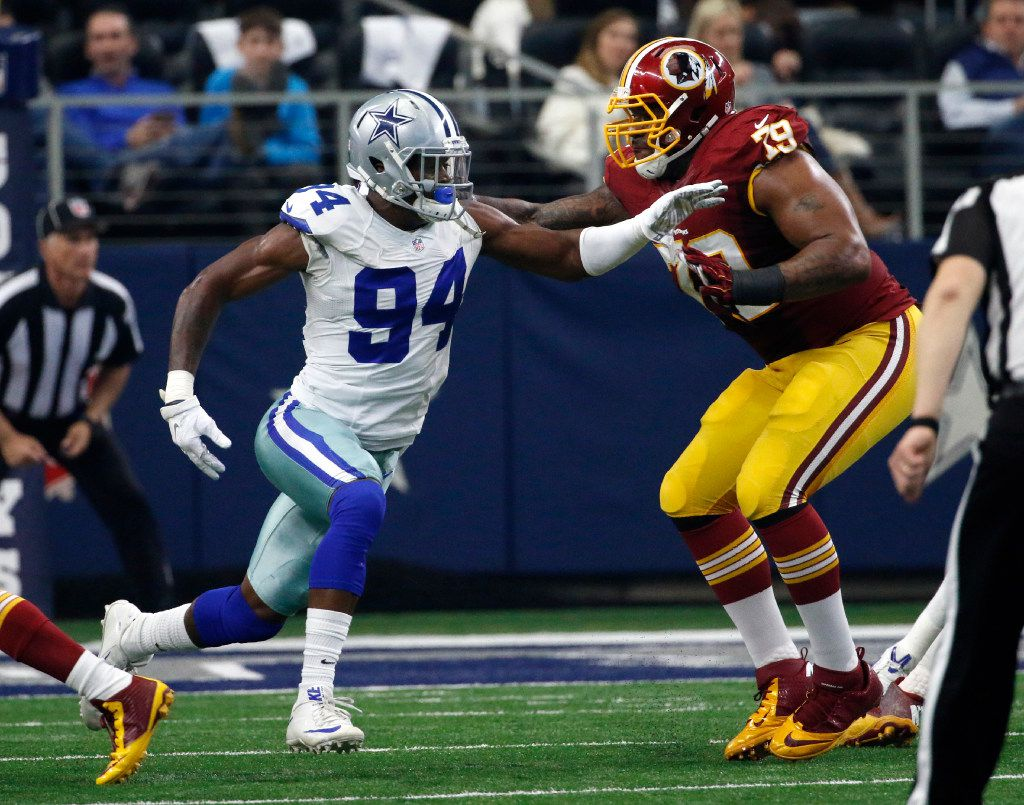 In this photo taken Jan. 3, 2016, Washington Redskins tackle Ty Nsekhe (79) blocks Dallas Cowboys defensive end Randy Gregory (94) during an NFL football game in Arlington, Texas.