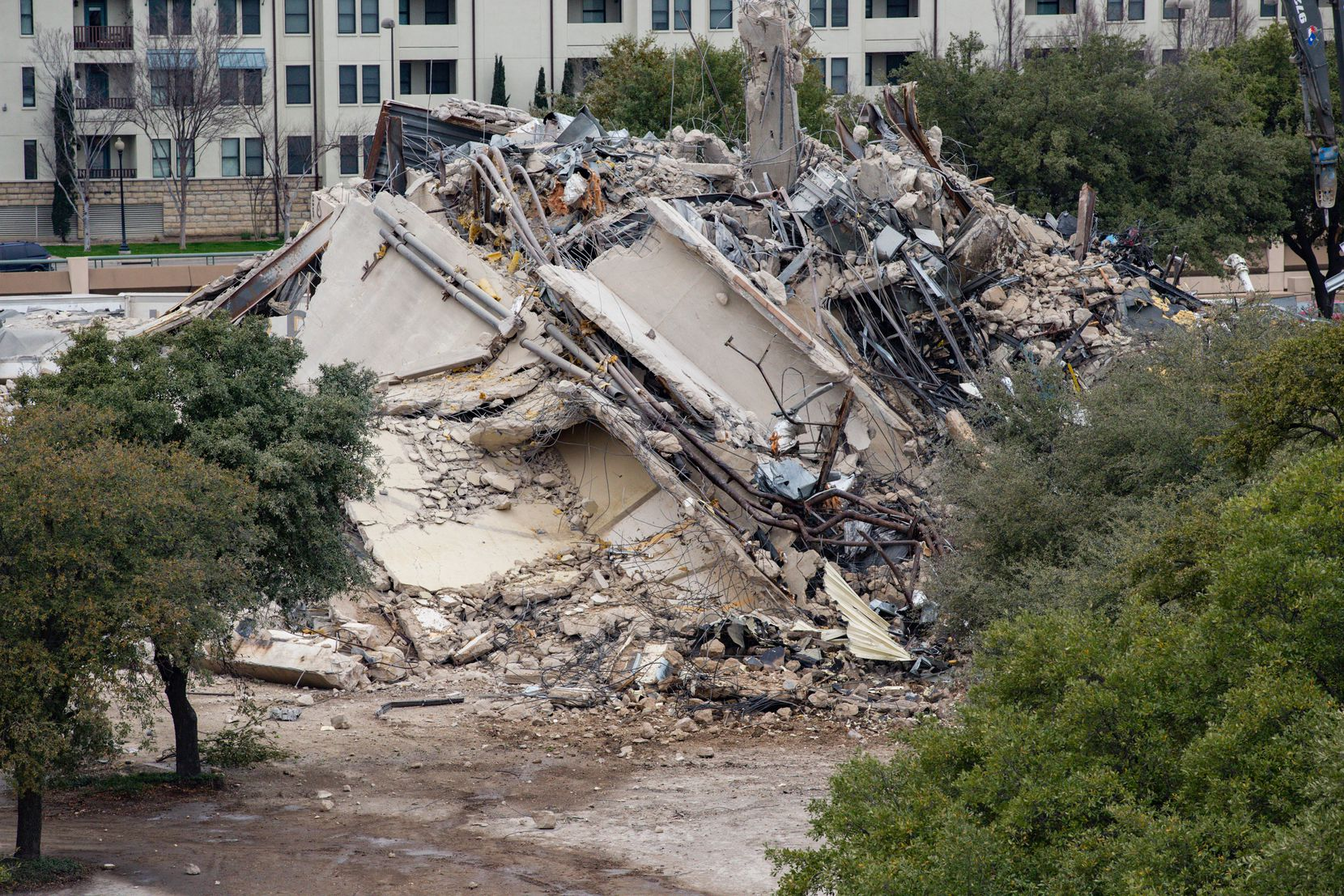 The remains of the Affiliated Computer Services building, or the Leaning to Tower of Dallas, at 2828 N. Haskell Ave. after finally falling over on Mar. 02, 2020, in Dallas. (Juan Figueroa/The Dallas Morning News)
