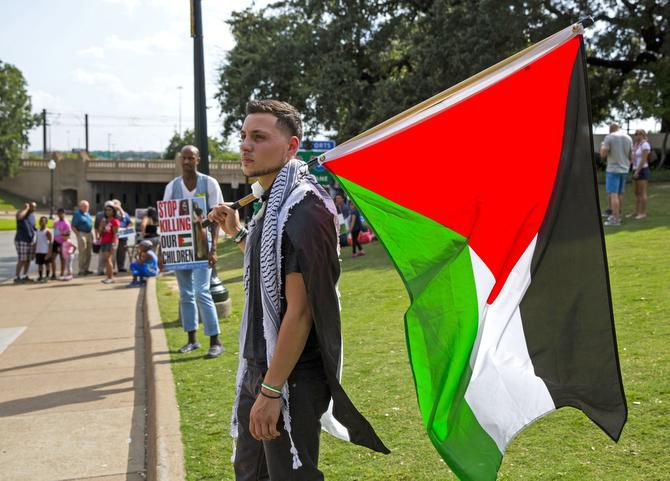 Mahir Hassan of Arlington  brought the Palestinian flag to a rally at Dealey Plaza in on Sunday.