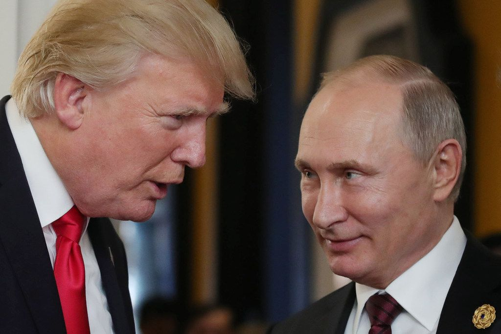 President Donald Trump speaks with Russian President Vladimir Putin at the APEC Economic Leaders' Meeting in Danang, Vietnam, in November. (Mikhail Klimentyev/Agence France-Presse)
