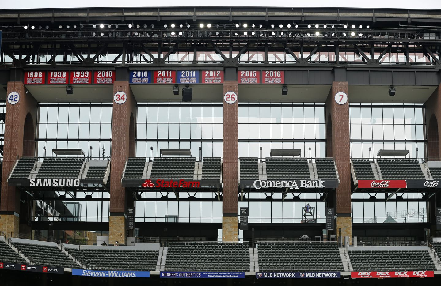 The Texas Rangers pennants hang above the left field seating along with the retired numbers players at the new completed Globe Life Field in Arlington, Wednesday, May 20 2020. (Tom Fox/The Dallas Morning News)
