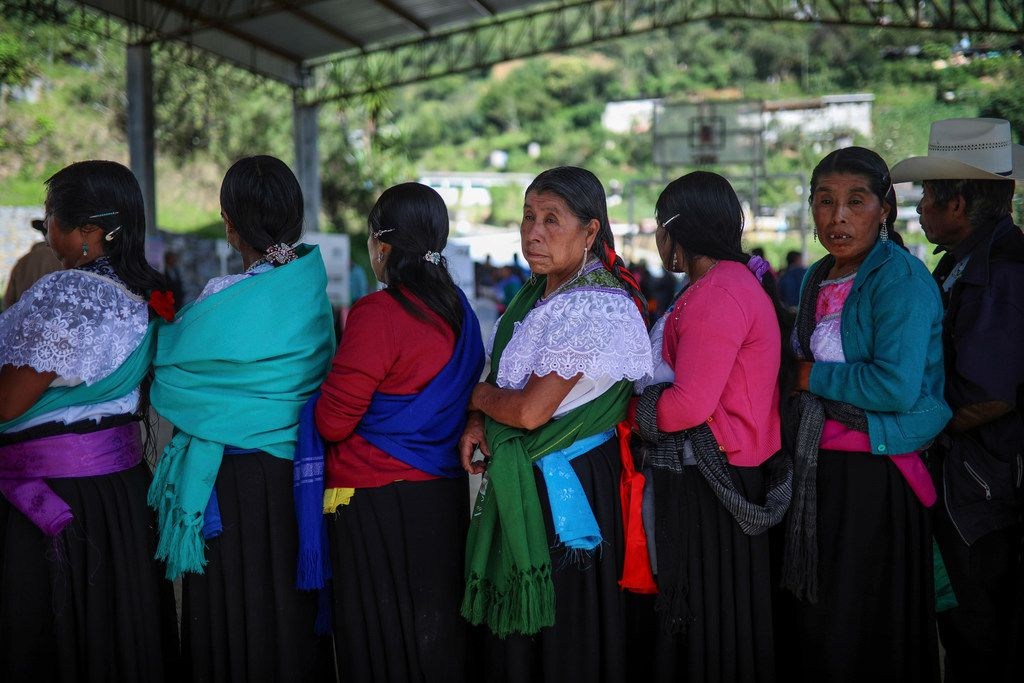 In this July 1, 2018 photo, people wait to vote during general elections in the indigenous community of Soledad Atzompa, Veracruz state, Mexico.
