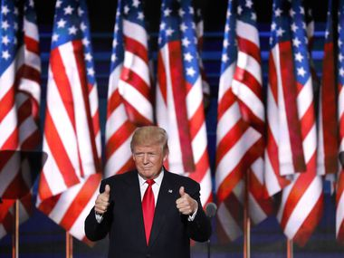 Donald Trump takes the stage to accept the party nomination for president on the final day of the Republican National Convention on Thursday, July 21, 2016, in Cleveland.