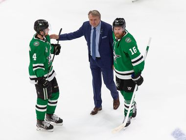 Miro Heiskanen (4), interim head coach Rick Bowness and Joe Pavelski (16) of the Dallas Stars react to their loss against the Tampa Bay Lightning during Game Six of the Stanley Cup Final at Rogers Place in Edmonton, Alberta, Canada on Monday, September 28, 2020.