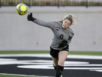 Marcus goalkeeper Bry Russell (0) brings out the soccer ball after a stop during the second half as Richardson Pearce played Flower Mound Marcus in the Class 6A Area Round playoff soccer game at Children's Health Stadium in Prosper on Monday, March 29, 2021.