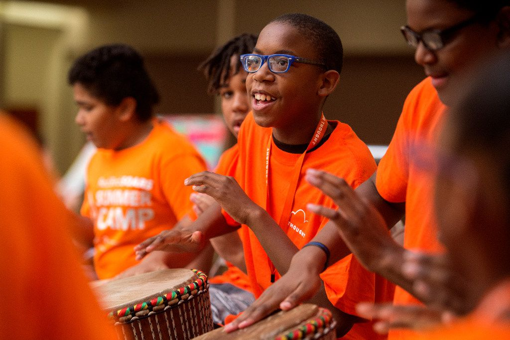 Campers play  African drum during the Red Bird SOARS summer camp.