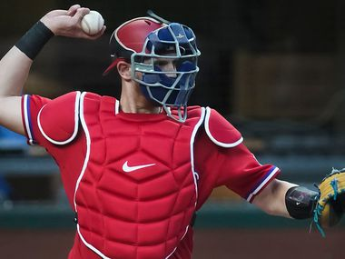 Texas Rangers catcher Sam Huff makes a warmup throw during the first inning against the Oakland Athletics at Globe Life Field on Friday, Sept. 11, 2020.