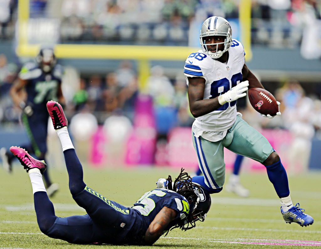 Dallas Cowboys wide receiver Dez Bryant (88) gets by Seattle Seahawks cornerback Richard Sherman during the first half of their game Sunday, October 12, 2014 at CenturyLink Field in Seattle, Wash. (G.J. McCarthy/The Dallas Morning News)