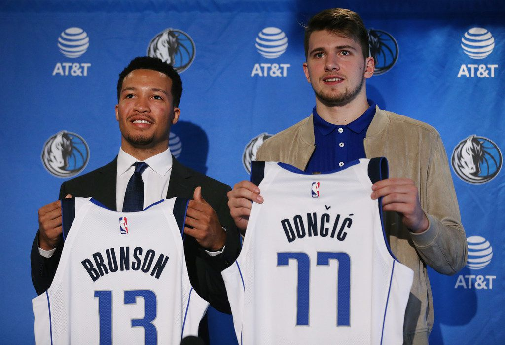 New Dallas Mavericks players Jalen Brunson (left) and Luka Doncic are introduced at the American Airlines Center in Dallas on Friday, June 22, 2018.