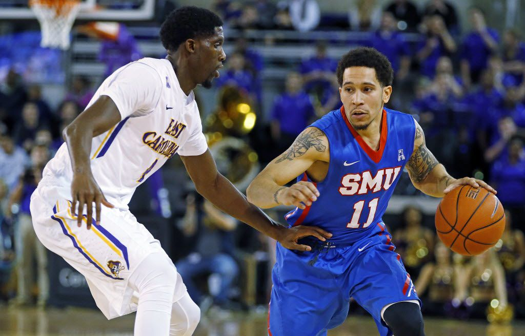 FILE - SMU's Nic Moore (11) tries to drive the ball around East Carolina's Prince Williams (4) during the first half of a game in Greenville, N.C., on Wednesday, Jan. 13, 2016. (AP Photo/Karl B DeBlaker)