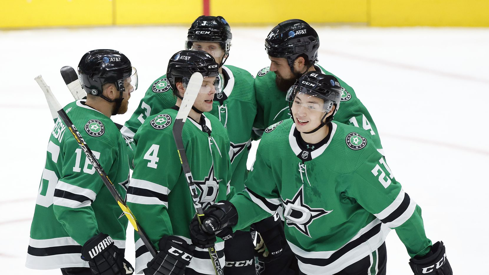 Dallas Stars left wing Jason Robertson (21) is congratulated by teammates after scoring a first period goal against the Florida Panthers at the American Airlines Center in Dallas, Tuesday, April 13, 2021.