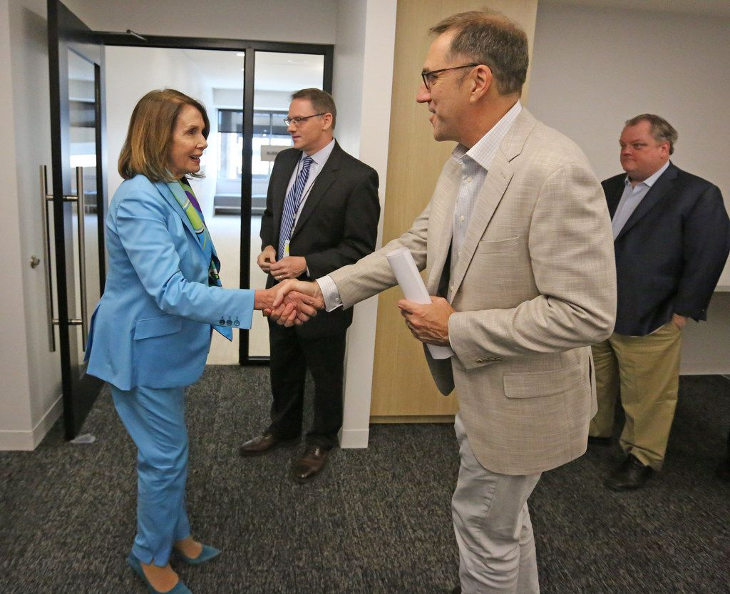 US House Minority Leader Nancy Pelosi shakes hands with DMN Editor Mike Wilson as she arrives for a meeting with the Dallas Morning News' editorial board to discuss the Democrats' plan called the Better Deal on Friday, May 11, 2018 at the DMN offices in Dallas.  (Louis DeLuca/The Dallas Morning News)