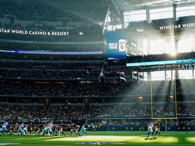 FILE - Sunlight steams through the windows of AT&T Stadium during the first half of a game between the Dallas Cowboys and Washington on Sunday, Dec. 29, 2019, in Arlington.