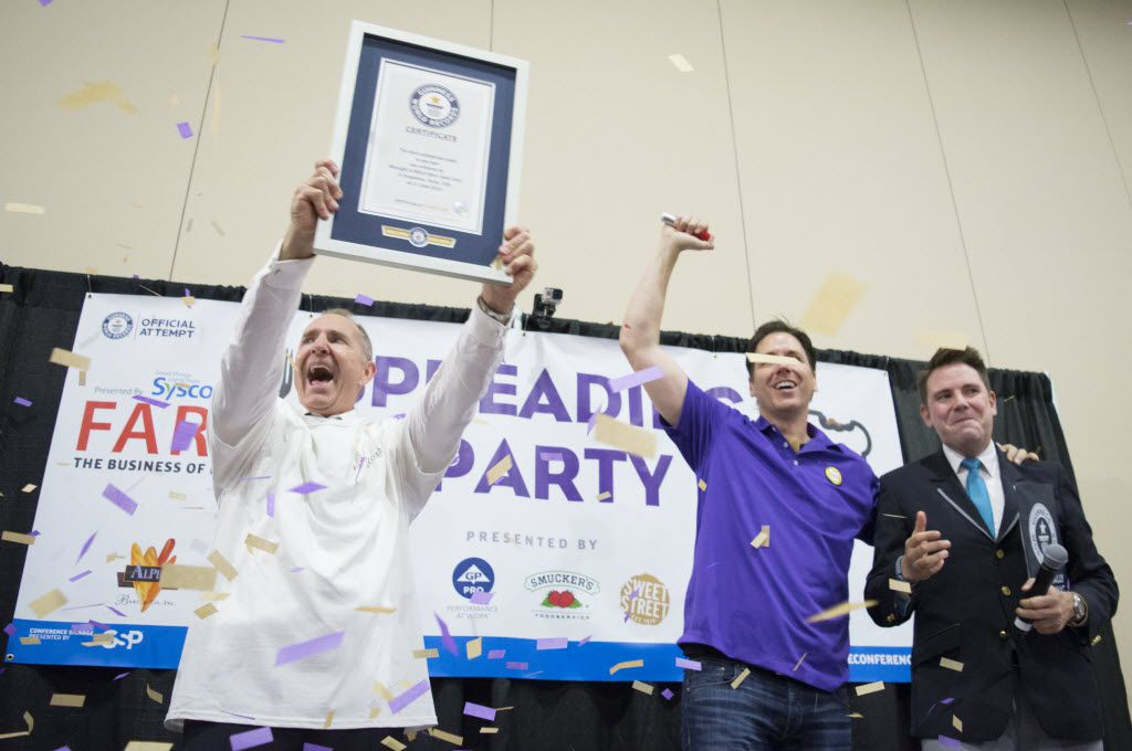 David Jobe, the Chief Customer Officer of Winsight Media, the company that runs the FARE Conference, raises Spread the Love's new Guinness World Record plaque for making 39303 PB&J sandwiches in one room in one hour. David Jobe, the Chief Customer Officer of Winsight Media, the company that runs the FARE Conference, raises Spread the Love's new Guinness World Record plaque for making 39303 PB&J sandwiches in one room in one hour.