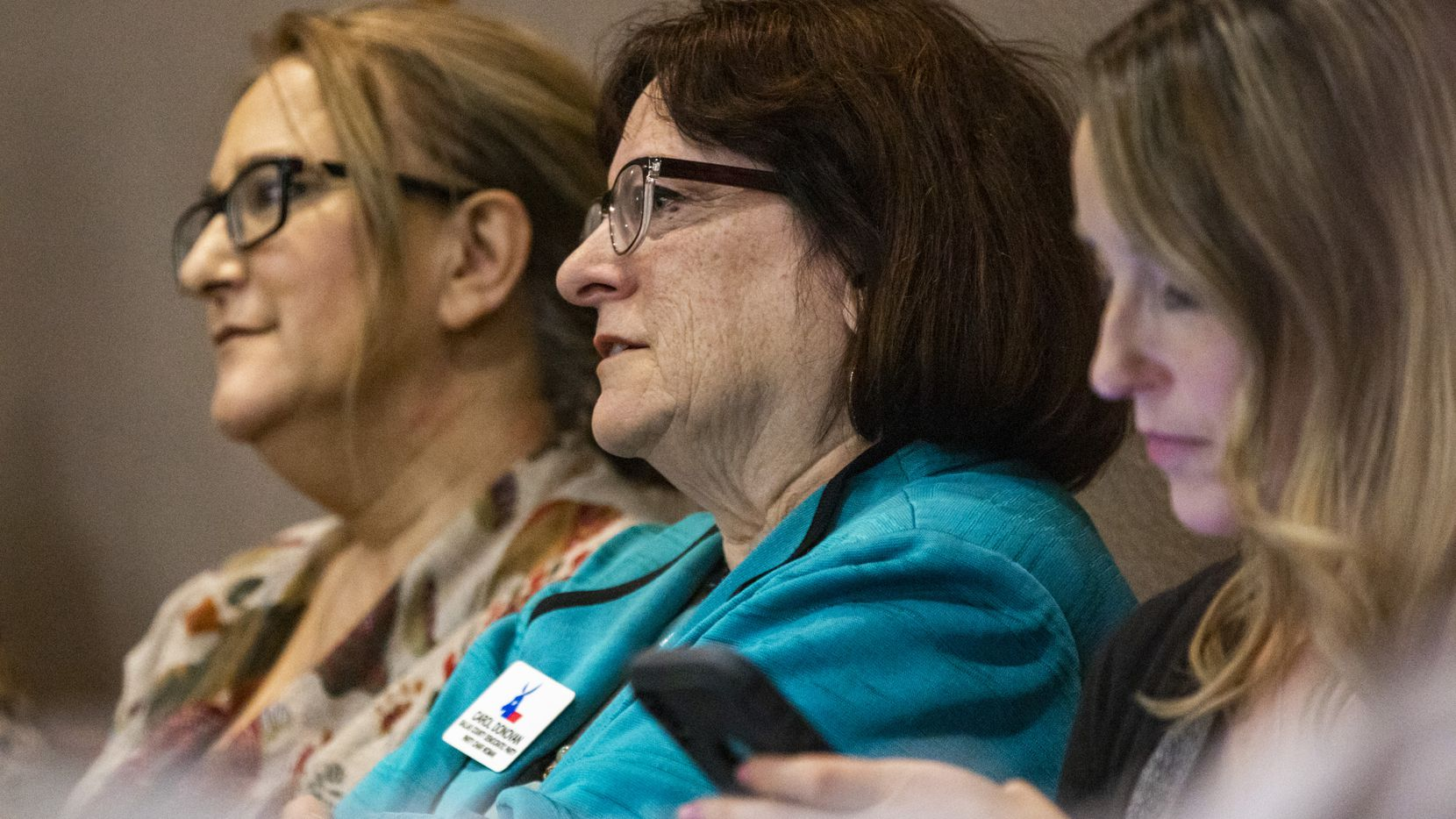 Dallas County Democratic Party Chair Carol Donovan, center, will resign later this year. In this file photo, she listens to testimony during a hearing before Judge Emily Tobolowsky at the George Allen Dallas County Civil Court building in downtown Dallas on Tuesday, March 10, 2020. (Lynda M. Gonzalez/The Dallas Morning News)
