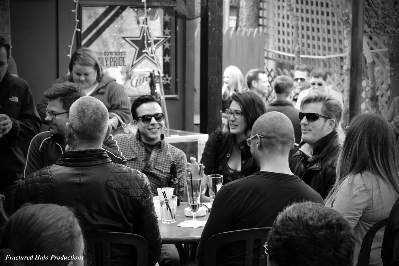 Friends drink on the covered back patio at the Grapevine Bar.