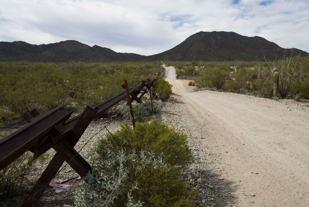 Vehicle barriers line a section of the U.S.-Mexico border that runs through Arizona.