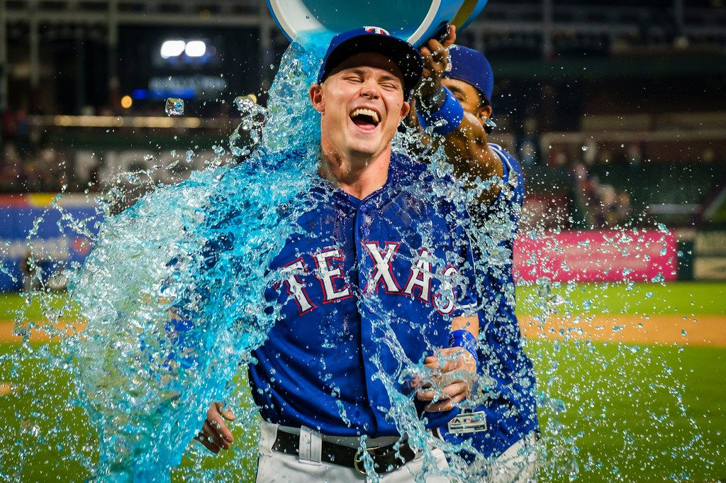 Texas Rangers outfielder Scott Heineman is doused by shortstop Elvis Andrus after the Rangers 5-4 victory over the Detroit Tigers in Heineman first major league game at Globe Life Park on Friday, Aug. 2, 2019, in Arlington. Heineman was 2-4 with two singles in his debut. (Smiley N. Pool/The Dallas Morning News)