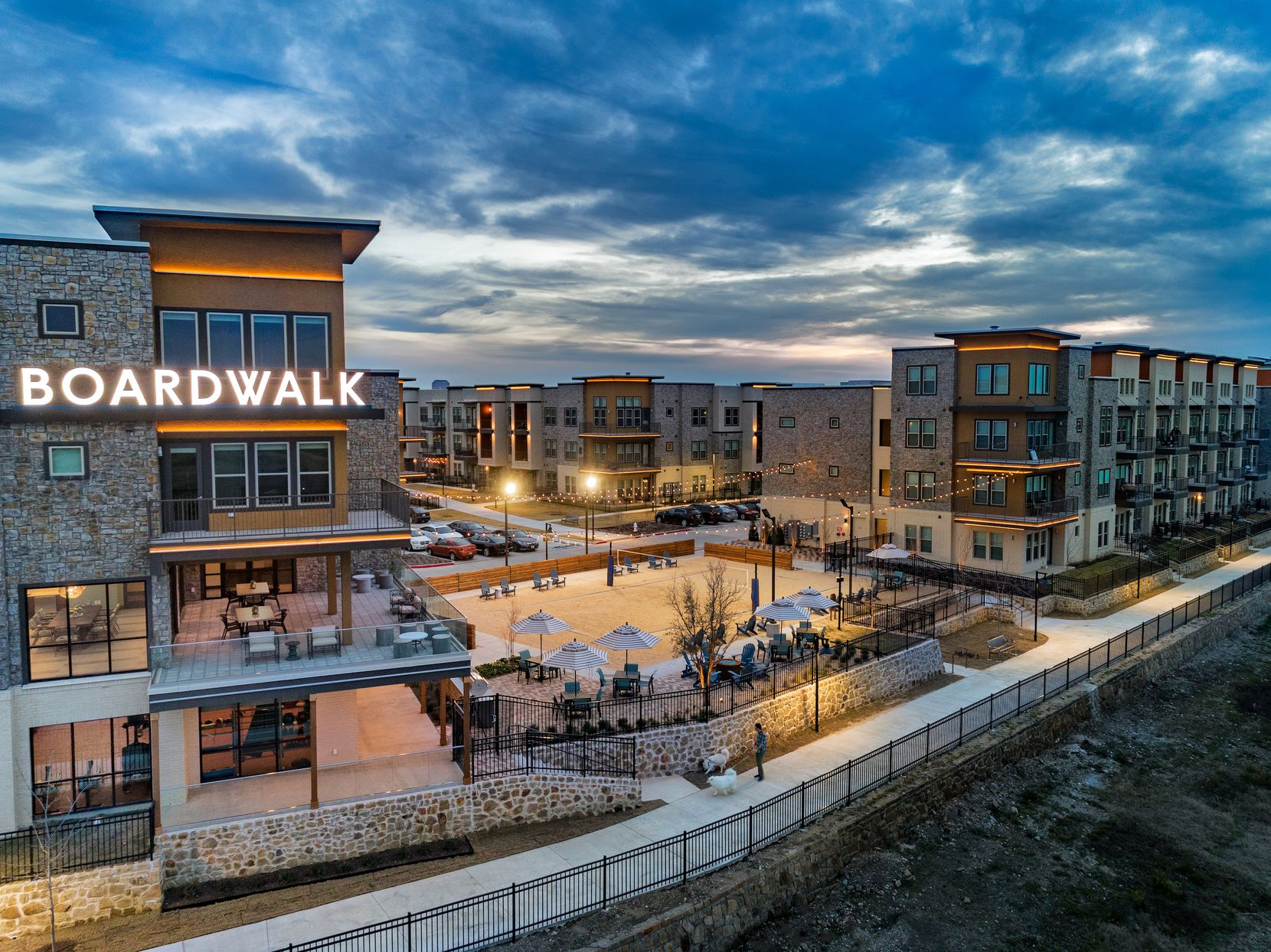 The Jefferson Boardwalk apartments in Farmers Branch are one of eight D-FW rental communities builder JPI sold to Lone Star Funds.