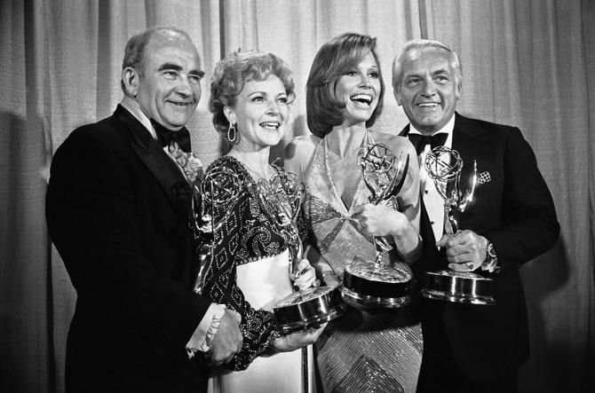 In this May 18, 1976 file photo, cast members of the Mary Tyler Moore Show, pose with their Emmys backstage, at the 28th annual Emmy Awards in Los Angeles. From left are, Ed Asner, who plays the news director on the show but won his Emmy for his role in Rich Man Poor Man; Betty White, supporting actress; Moore for best actress in a comedy show and Ted Knight for supporting actor.