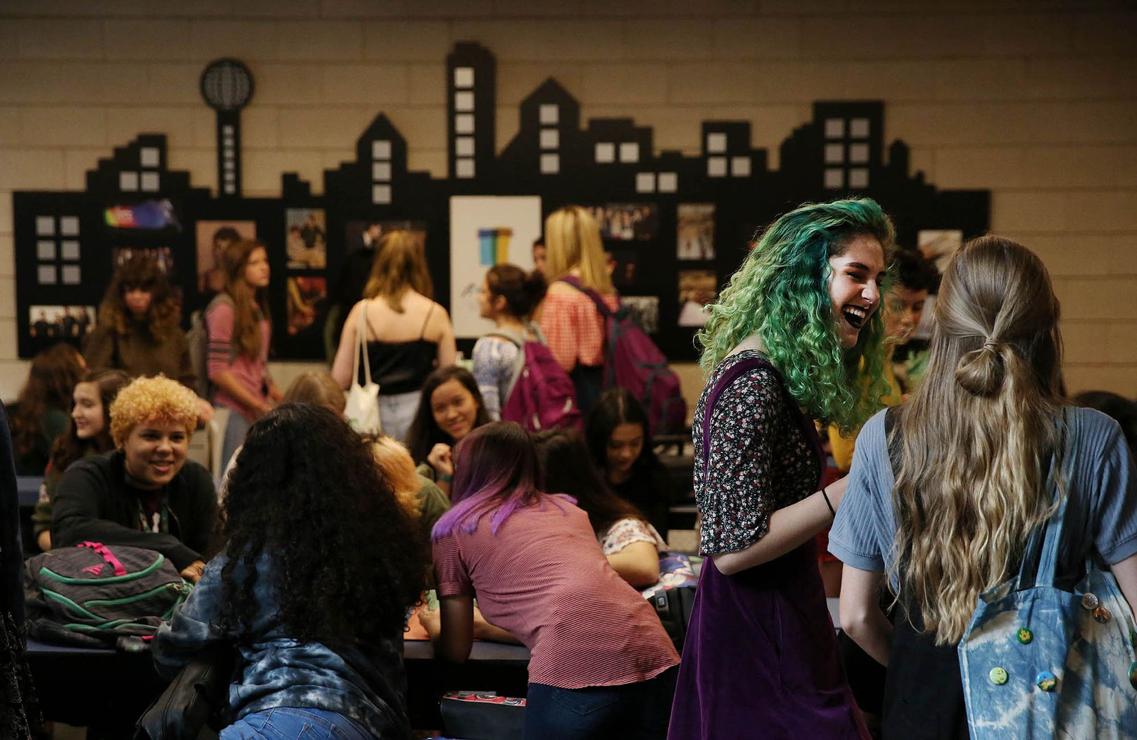 Isabella Bruner, a junior, speaks to her peer during the first day of school in the 2017 Dallas Independent School District school year at Booker T. Washington High School.