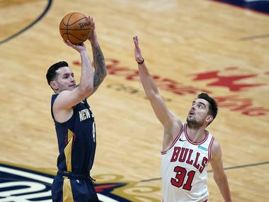 Pelicans guard JJ Redick shoots over Bulls guard Tomas Satoransky (31) during the first half of a game in New Orleans on Wednesday, March 3, 2021. (AP Photo/Gerald Herbert)