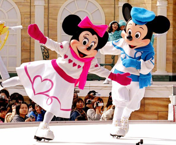 TOKYO, JAPAN:  Mickey and Minnie Mouse show their skating performance on ice at the Tokyo Disney Sea 04 November 2003 as Tokyo's Disney teme parks started the new shows for Christmas which will be carried through until Christmas Day.     AFP PHOTO / Yoshikazu TSUNO  (Photo credit should read YOSHIKAZU TSUNO/AFP/Getty Images)