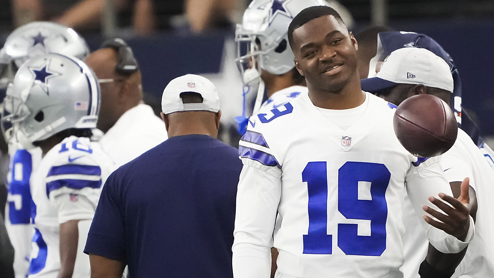 Dallas Cowboys wide receiver Amari Cooper tosses a ball on the sidelines during the first half of a preseason NFL football game against the Jacksonville Jaguars at AT&T Stadium on Sunday, Aug. 29, 2021, in Arlington.
