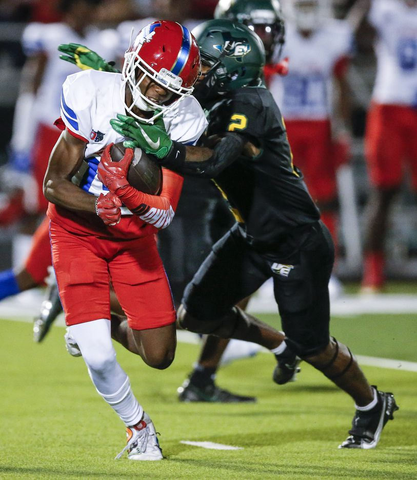 Duncanville senior punt returner Davion Bluitt (14) slips a tackle from DeSoto senior Mike Murphy (2) on a punt return during the first half of a high school football game at DeSoto High School, Friday, September 17, 2021. Bluitt would run the ball back for a touchdown. (Brandon Wade/Special Contributor)