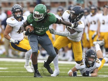 Bryan Adams running back Kenvodrick Shaw (2) works to break away from Highland Park defensive linemen Prince Dorbah (32) and Chris Read (24) during the first quarter of a matchup between Highland Park and Bryan Adams on Friday, Sept. 21, 2018 at Forester Field in Dallas.